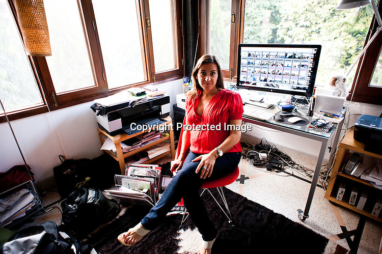 Award winning Photojournalist, Lynsey Addario poses for a portrait in her home office in New Delhi, India. Photo: Sanjit Das
