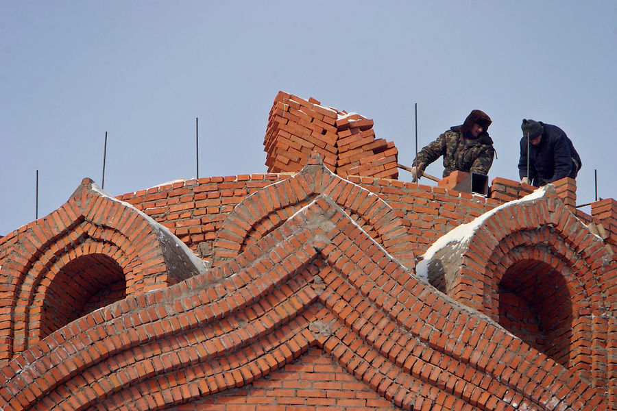 Khabarovsk, Russia, 01/03/2004.&amp;#xD;Constructing a new Russian Orthodox church in the city centre.&amp;#xD;<br />