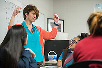 NWA Democrat-Gazette/ANTHONY REYES @NWATONYR<br /> Traci Tompkins math teacher at Springdale High School, assists her students with a problem Thursday, April 13, 2017 during Algebra II at the school. Tompkins class is using a newer system for learning that involves more group based problem solving.