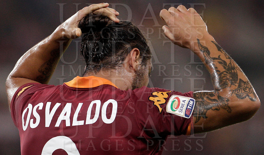 Calcio, Serie A: Roma-Catania. Roma, stadio Olimpico, 26 agosto 2012..AS Roma forward Pablo Daniel Osvaldo reacts after missing a scoring chance during the Italian Serie A football match between AS Roma and Catania, at Rome, Olympic stadium, 26 August 2012. .UPDATE IMAGES PRESS/Riccardo De Luca