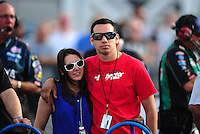 Mar. 30, 2012; Las Vegas, NV, USA: NHRA pro stock motorcycle rider Hector Arana Jr (right) with girlfriend Nicole Nobile during qualifying for the Summitracing.com Nationals at The Strip in Las Vegas. Mandatory Credit: Mark J. Rebilas-