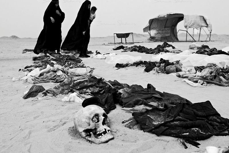 Near Nedjaf, Iraq, May 27, 2003.Two women try to identify the remains of family members who disappeared in 1991 during the Shia'i intifada following the Gulf War. Many mass graves litter the desert around Nedjaf and Kerbala. Unfortunately, the diggings are often executed without proper methodology which leads to the destruction of evidence against the perpetrators but perhaps more crucialy prevents accurate identifications of the remains.