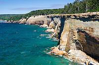 The amazing Pictured Rocks National Lakeshore shoreline on a beautiful summer day. Munising, MI