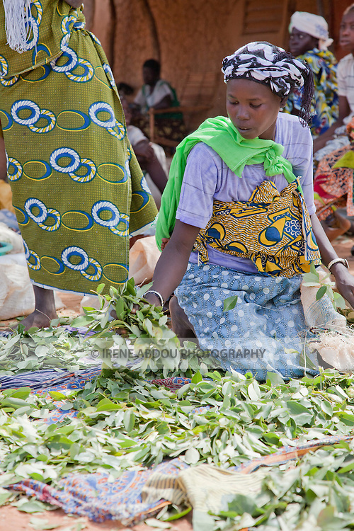 In the town of Djibo in northern Burkina Faso, women sell greens in the market.