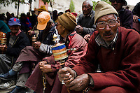 An elderly Ladakhi man spins a handheld mani prayer wheel as he chants prayers in Chokhang Vihara, the central monastery in Leh town, Ladakh, Jammu & Kashmir, India, on 30th May 2009. Locals gather there to chant and pray together for the 6th Tara Ceremony 2009, which is presided over by a high lama, the venerable 9th Choegon Rinpoche.  Photo by Suzanne Lee