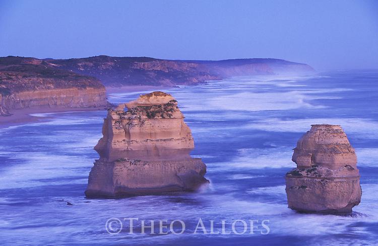 Australia, Victoria, Great Ocean Road; Rock pillars in ocean near Twelve Apostles in Port Campbell National Park at dawn