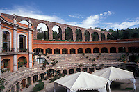 The Quinta Real Zacatecas hotel located in Mexico's oldest bullring, city of Zacatecas, Mexico. The Del Cubo 18th century aqueduct is in the background.