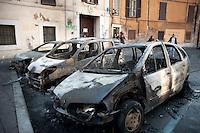 Roma  15 Ottobre 2011.Manifestazione contro la crisi e l'austerità.Automobili bruciate in via Labicana