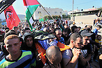 Palestinians carry the body of 18-year-old Palestinian Mahmud Nazal during his funeral in the village of Qabatiya, south of the West Bank city of Jenin, on October 31, 2015, after he was killed at the al-Jalama checkpoint by Israeli security forces after he tried to stab a private security guard, Israeli police said. The incident took the toll of Palestinians killed this month in clashes with police or while carrying out attacks on Israelis, to over 50. Photo by Nedal Eshtayah