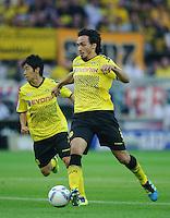 Fussball Bundesliga Saison 2011/2012 1. Spieltag Borussia Dortmund - Hamburger SV V.l.: Shinji KAGAWA (BVB), Mats HUMMELS (BVB).
