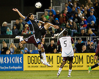 Alan Gordon of Earthquakes battles for the ball in the air against Tyrone Marshall of Rapids during the game at Buck Shaw Stadium in Santa Clara, California on August 25th, 2012.   San Jose Earthquakes defeated Colorado Rapids, 4-1.
