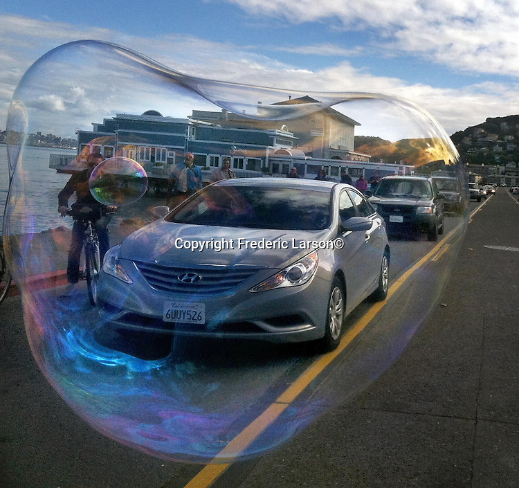 The bubble man of Sausalito stops traffic with his magic on March 30, 2012