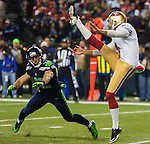Seattle Seahawks  free safety Chris Managos (42) tries to block the punt by San Francisco punter Andy Lee (4) during their NFL  Championship Game against the San Francisco 49ers at CenturyLink Field in Seattle, Washington on January 19, 2014.  The Seahawks beat the 49ers 23-17 to represent the NFC in the Super Bowl.  ©2014. Jim Bryant Photo. ALL RIGHTS RESERVED.