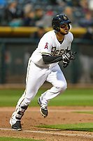 Francisco Arcia (5) of the Salt Lake Bees hustles down the first base line against the Sacramento River Cats during the Pacific Coast League game at Smith's Ballpark on August 11, 2017 in Salt Lake City, Utah. The River Cats defeated the Bees 8-7. (Stephen Smith/Four Seam Images)
