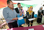 Women refugees from Syria graduate from a Start Your Business course in Zarqa, Jordan. The 15-day course was sponsored by the Department of Service for Palestinian Refugees of the Middle East Council of Churches, a member of the ACT Alliance. Refugees are not allowed to obtain formal employment in Jordan, but the women can run small businesses from their homes.