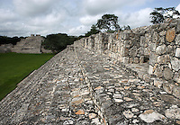 Nohochná ?The Big House?, four long halls with openings between thick square columns, South Temple in the distance, Puuc architectural style, Late Classic Period, 600 - 900 AD, Edzna, Campeche, Mexico. Building used for administrative tasks; wideness of the staircase suggests a possible second use as benches for spectators during special events in the Main Plaza. Picture by Manuel Cohen