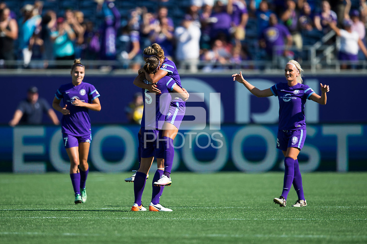 Orlando, FL - Sunday May 08, 2016: Orlando Pride players including defender Laura Alleway (5) celebrate a goal by forward Sarah Hagen (8) during a regular season National Women's Soccer League (NWSL) match at Camping World Stadium.