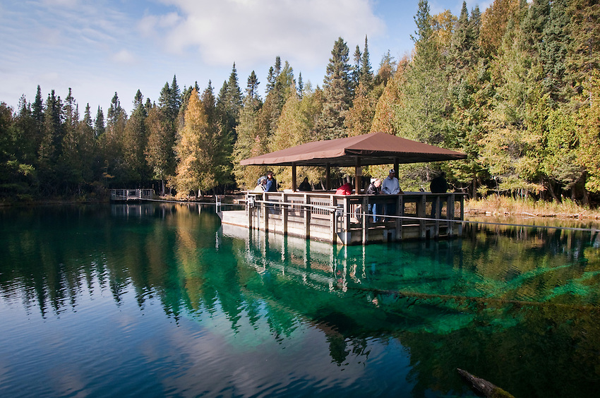 Visitors to Palm Book State Park near Manistique Michigan explore the parks key feature the Kitch-iti-kipi or the Big Spring via raft.