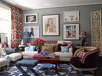 The ottoman, linen-covered chairs and velvet armchair, which has been upholstored in a Braquenie cotton, are by the owner and the photograph of Gisele Bundchen is by Michel Comte
