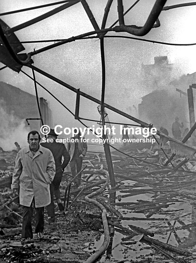 Proprietors and staff of retail units pick their way though the  devastation following a blaze at Smithfield Market, Belfast, N Ireland, UK, May 1974. 197405000248e<br /> <br /> Copyright Image from Victor Patterson, 54 Dorchester Park, Belfast, UK, BT9 6RJ<br /> <br /> Tel: +44 28 9066 1296<br /> Mob: +44 7802 353836<br /> Voicemail +44 20 8816 7153<br /> Email: victorpatterson@me.com<br /> Email: victorpatterson@gmail.com<br /> <br /> IMPORTANT: My Terms and Conditions of Business are at www.victorpatterson.com