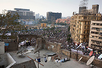 A view over a protest in Tahrir Square. Continued anti-government protests take place in Cairo calling for President Mubarak to stand down. After dissolving the government, Mubarak still refuses to step down from power.