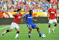 Korede Alyegbusi (blue), Rafael...Kansas City Wizards defeated Manchester United 2-1 in an international friendly at Arrowhead Stadium, Kansas City, Missouri.