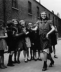 East End girl dancing the Lambeth Walk, 1937
