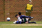 27 November 2005: SMU's Paulo daSilva (13) puts the ball off the right post and past UNC-G goalkeeper Jay Benfield (behind) for the game's first goal, scored in the 11th minute. Southern Methodist University defeated the University of North Carolina at Greensboro 3-1 at UNC-G Soccer Stadium in Greensboro, North Carolina in a 2005 NCAA Men's Soccer Tournament game.