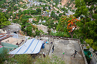 Two boys kick a soccer ball on a rooftop on July 7, 2010 in Port-au-Prince, Haiti.