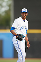 Dunedin Blue Jays starting pitcher Angel Perdomo (52) smiles on the mound while warming up during a game against the St. Lucie Mets on April 19, 2017 at Florida Auto Exchange Stadium in Dunedin, Florida.  Dunedin defeated St. Lucie 9-1.  (Mike Janes/Four Seam Images)