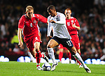 Lee Cattermole chases Joe Allen. England U21 V Wales U21, Uefa European U21 Championship qualifying play-off second leg &copy; Ian Cook IJC Photography iancook@ijcphotography.co.uk www.ijcphotography.co.ukUnholy Alliance Tour 2008,