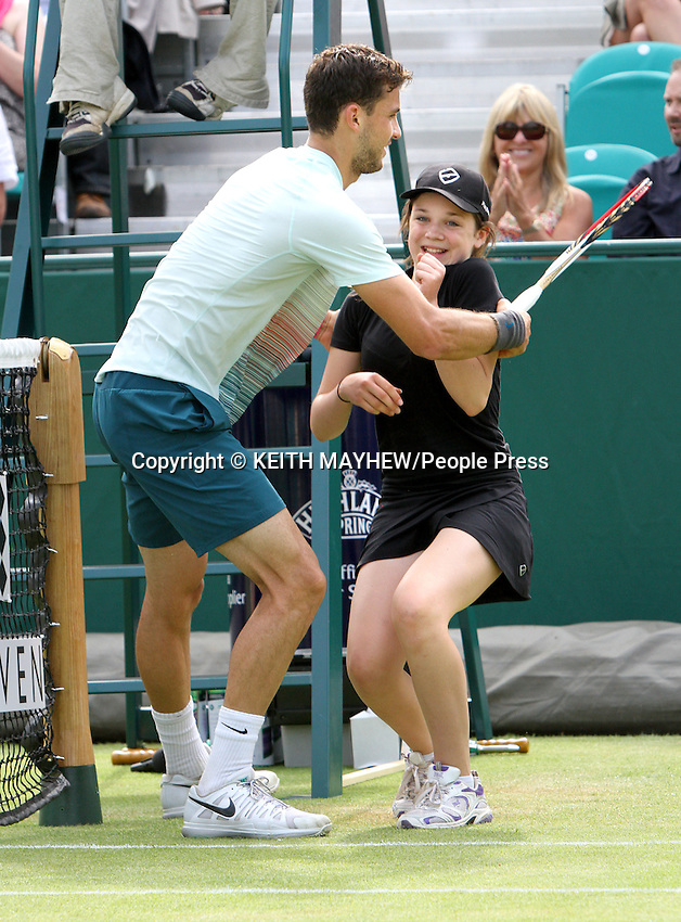 Grigor Dmitrov (Bulgaria) plays Jerzy Janowicz (Poland) at The Boodles Tennis Challenge held at Stoke Park, Buckinghamshire, UK - June 21st 2013<br /> <br /> Photo by Keith Mayhew