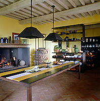 There is a fascinating juxtaposition of ancient ceiling beams and modern woodwork in this Italian kitchen