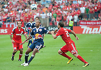 August 21 2010 New York Red Bulls forward Thierry Henry #14 and Toronto FC midfielder Martin Saric #25 in action during a game between the New York Red Bulls and Toronto FC at BMO Field in Toronto..The New York Red Bulls won 4-1.