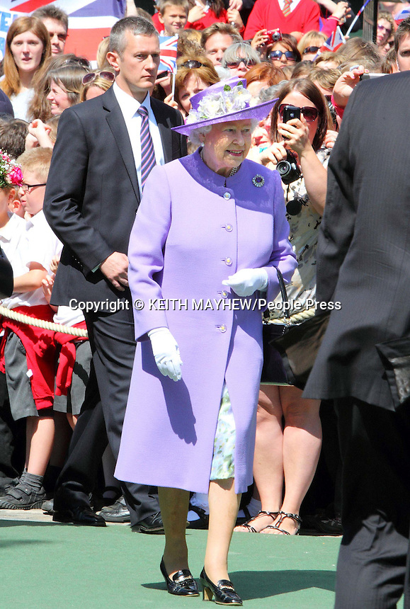 Hitchin, Hertfordshire - Her Majesty Queen Elizabeth II continues her Diamond Jubilee tour of Britain with a visit to the Hertfordshire market town of Hitchin, England - June 14th 2012..Photo by Keith Mayhew