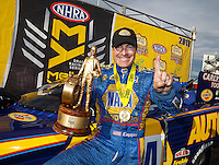 Aug 20, 2016; Brainerd, MN, USA; NHRA funny car driver Ron Capps celebrates after winning the Protect the Harvest Nationals from Seattle, WA that was delayed by rain to run during qualifying for the Lucas Oil Nationals at Brainerd International Raceway. Mandatory Credit: Mark J. Rebilas-USA TODAY Sports