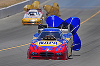 Jul. 26, 2009; Sonoma, CA, USA; NHRA funny car driver Ron Capps (near) after defeating Ashley Force Hood in the first round during eliminations in the Fram Autolite Nationals at Infineon Raceway. Mandatory Credit: Mark J. Rebilas-