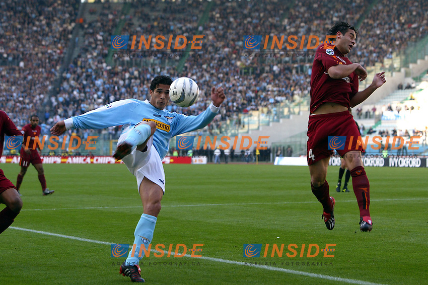 Roma 21/4/2004 Campionato Italiano Serie A <br /> Lazio - Roma 1-1 <br /> Bernardo Corradi (Lazio) crossa contrastato da Christian chivu (Roma)<br /> Bernardo Corradi (Lazio) challenged by Christian Chivu (Roma)<br /> Lazio and Roma are playing again after it was suspended on March 21, 2004, for security reasons.  <br /> Foto Andrea Staccioli Insidefoto