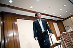 Thaksin Shinawatra, former prime minister of Thailand, leaves the podium after giving a group interview at the Imperial Hotel in Tokyo, Japan on 23 Aug. 2011. Photographer: Robert Gilhooly