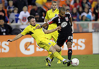 WASHINGTON, DC - OCTOBER 20, 2012:  Maicon Santos (29) of D.C United loses the ball to a tackle from Danny O'Rourke (5) of the Columbus Crew during an MLS match at RFK Stadium in Washington D.C. on October 20. D.C United won 3-2.
