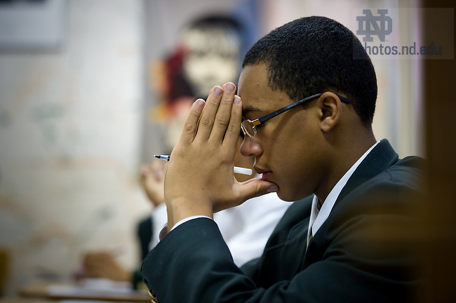 Feb. 17, 2011; A student prays at the beginning of class at Archbishop Carroll High School in Washington, D.C....Photo by Matt Cashore/University of Notre Dame