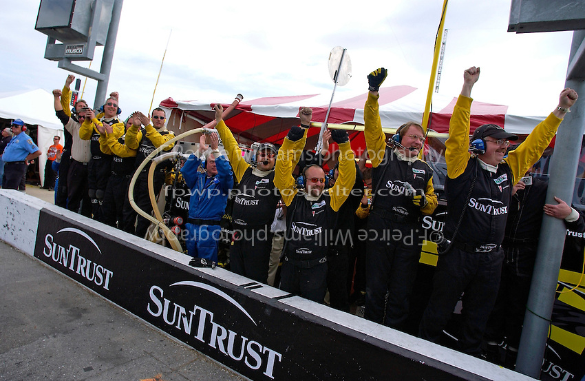 .#10 SunTrust Pontiac/Riley team celebrates as their crosses the line to win.
