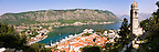 Panoramic view from the medieval  hill fortifications above Kotor across roof tops and Kotor Bay - Montenegro