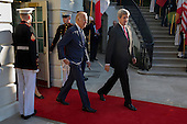 US Vice President Joseph Biden (L) and US Secretary of State John Kerry (R) walk out of the White House to participate in an official arrival ceremony for  Italian Prime Minister Matteo Renzi and Italian First Lady Agnese Landini on the South Lawn of the White House in Washington DC, USA, 18 October 2016. Later today President Obama and First Lady Michelle Obama will host their final state dinner featuring celebrity chef Mario Batali and singer Gwen Stefani performing after dinner. <br /> Credit: Shawn Thew / Pool via CNP