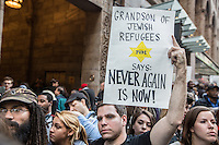 NEW YORK,NY APRIL 14: A man holds a sign during the anti-Trump protest near Grand Central Station in midtown Manhattan on April 14,2016 in New York City.Photo by VIEWpress/Maite H. Mateo