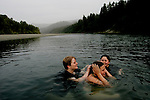From left, Sami Frye, 17, Casey Hall, 12, and Patricia Johnson, 17, swim in the Eel River in Scotia, CA on Tuesday, June 27, 2006. Casey Hall is the fourth generation of her family to grow up in Scotia. The town of Scotia in Northern California is a company town owned by the Pacific Lumber Company (PALCO), but that will change as the company will begin to sell the town. (Photo by Max Whittaker for The New York Times)<br />