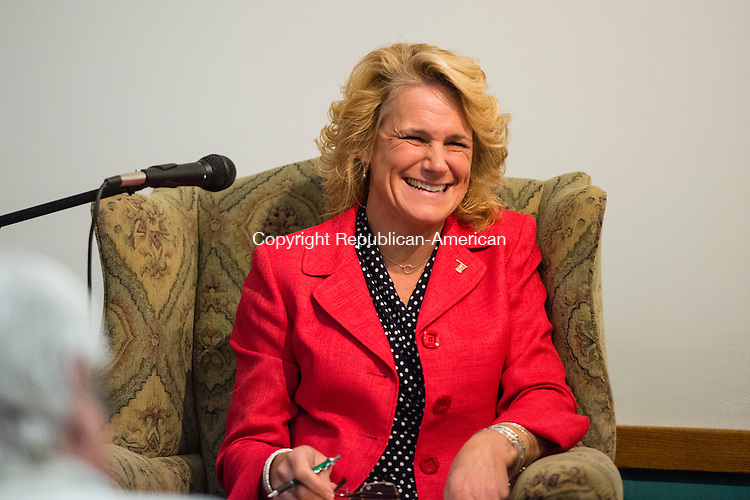 NAUGATUCK, CT- 20 October 2015-102015EC06-  Republican Tamath Rossi shares a light moment with democrat Warren Hess Tuesday night at the Howard Whittemore Memorial Library in Naugatuck. Erin Covey Republican-American