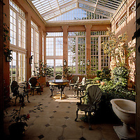 The conservatory is furnished with a collection of chairs fashioned like oversized scallop shells