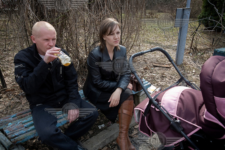 A couple sit with their baby in the town of Rodniki, near Ivanovo.