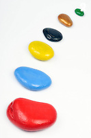 Line of multi-colored pebbles, studio shot (Licence this image exclusively with Getty: http://www.gettyimages.com/detail/96354155 )